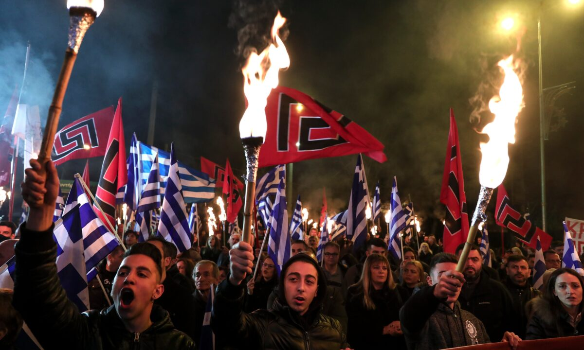 supporters of Greece's extreme right Golden Dawn raise torches