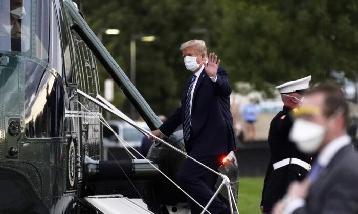 President Donald Trump boards Marine One at Walter Reed National Military Medical Center after receiving treatment for COVID-19, in Bethesda, Md., Oct. 5, 2020. (Evan Vucci/AP Photo)