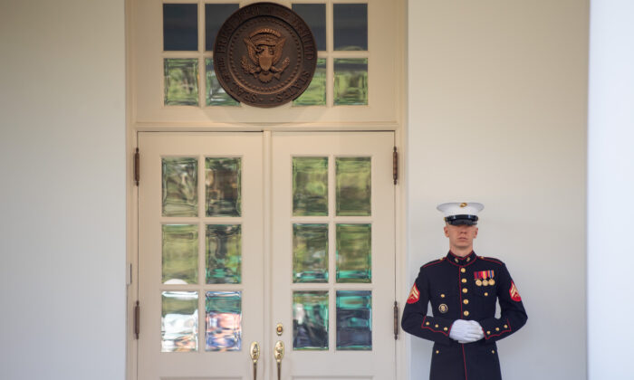 A US Marine stands guard outside the West Wing, indicating that President Donald Trump is in the Oval Office, at the White House in Washington, on Oct. 7, 2020. (Saul Loeb/AFP via Getty Images)