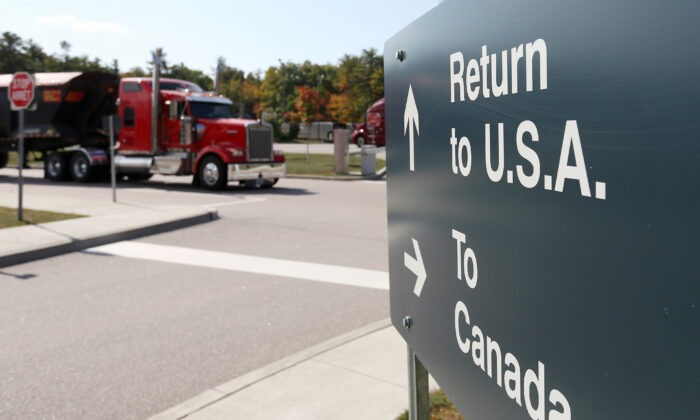 A truck leaves the Canada-United States border crossing at the Thousand Islands Bridge, which remains closed to non-essential traffic to combat the spread of the coronavirus disease (COVID-19) in Lansdowne, Ontario, Canada, on Sept. 28, 2020. (Lars Hagberg/Reuters)
