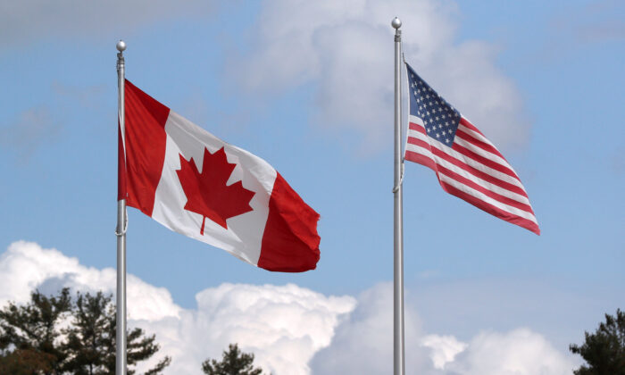 A U.S. and a Canadian flag flutter at the Canada-United States border crossing at the Thousand Islands Bridge, which remains closed to non-essential traffic to combat the spread of the coronavirus disease (COVID-19) in Lansdowne, Ontario, Canada, on Sept.r 28, 2020.  (Reuters/Lars Hagberg/File Photo)