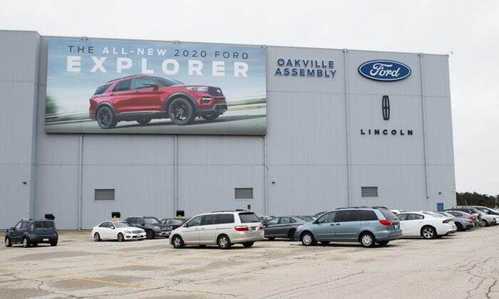 A parking lot with employees vehicles at the Ford assembly plant in Oakville, Ont., on March 19, 2020. (The Canadian Press/Nathan Denette)