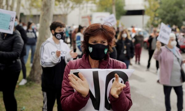 A demonstrator attends a protest towards lockdown