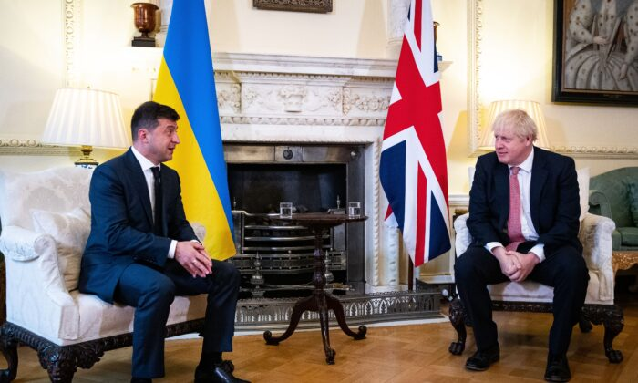 Britain's Prime Minister Boris Johnson (R) and Ukraine's President Volodymyr Zelenskyy gesture during their meeting inside number 10 Downing Street, in central London, on Oct. 8, 2020. (Aaron Chown/POOL/AFP via Getty Images)