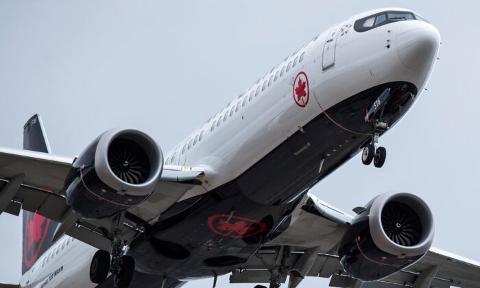 An Air Canada Boeing 737 Max 8 aircraft arriving from Toronto prepares to land at Vancouver International Airport, in Richmond, B.C., Canada on March 12, 2019. (Darryl Dyck/The Canadian Press)