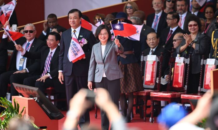 Taiwan President Tsai Ing-Wen (C) waves during National Day celebrations in front of the Presidential Palace in Taipei on Oct. 10, 2019. (Sam Yeh/AFP via Getty Images)