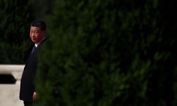 Chinese leader Xi Jinping walks to the Monument to the People's Heroes at Tiananmen Square in Beijing, China on September 30, 2020. (NOEL CELIS/AFP via Getty Images)