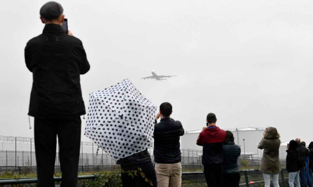 Spectators take images of a British Airways Boeing-747