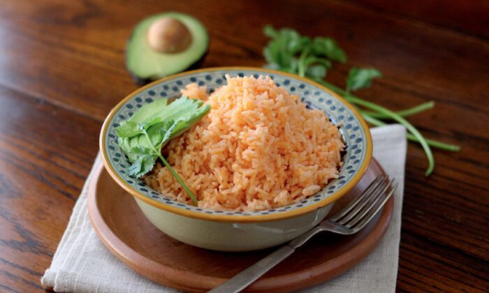 An essential side dish found on plates throughout Mexico, this red rice can accompany almost any meal. (Courtesy of Mely Martinez)