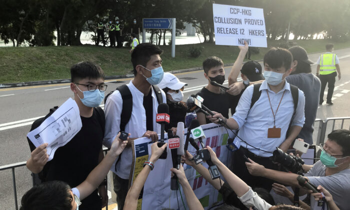 Pro-democracy activists Joshua Wong, Owen Chow, and family members of twelve Hong Kong activists arrested as they reportedly sailed to Taiwan for political asylum, speak to media after a protest outside the headquarters of Government Flying Service, in Hong Kong, on October 8, 2020. (Aleksander Solum/Reuters)