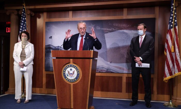 U.S. Senate Minority Leader Sen. Chuck Schumer (D-N.Y.) speaks as Sen. Amy Klobuchar (D-Minn.) and Sen. Chris Murphy (D-CT) listen during a news conference at the U.S. Capitol August 4, 2020 in Washington, DC. Senate Democrats held a weekly news conference to answer questions from members of the press. (Photo by Alex Wong/Getty Images)