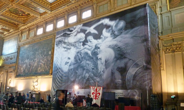 A 2012 view of a banner showing the painting which might be hidden behind the Vasari wall at its location in Florence's Palazzo Vecchio. Art sleuths taking part in the controversial  research, partly sponsored by National Geographic, said on March 12, 2012 that they believe they had found traces of a Leonardo da Vinci masterpiece that had not been seen in over four centuries. (DARIO THUBURN/AFP via Getty Images)