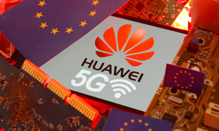 The EU flag and a smartphone with the Huawei and 5G network logo are seen on a PC motherboard in this illustration taken on Jan. 29, 2020. (Dado Ruvic/Reuters)