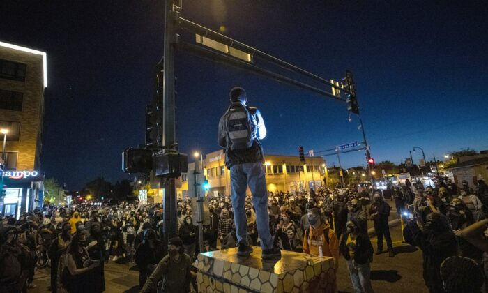 Demonstrators block an intersection in Minneapolis on Oct. 7, 2020, after Derek Chauvin, the former Minneapolis police officer charged with murder in the death of George Floyd, posted bail and was released from prison. (Carlos Gonzalez/Star Tribune via AP)