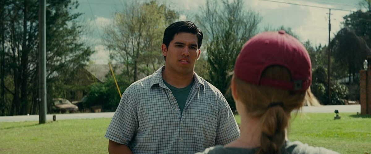 "woman with read baseball cap talks to high school pitcher in ""Trouble with the Curve"""