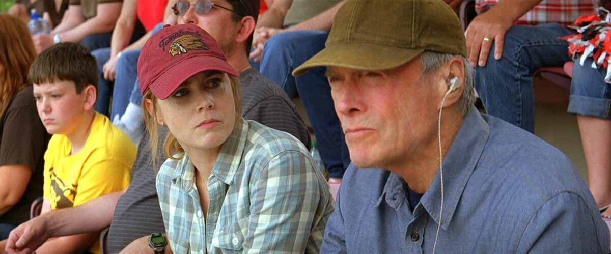 "man and woman in baseball caps at a game in ""Trouble with the Curve"""