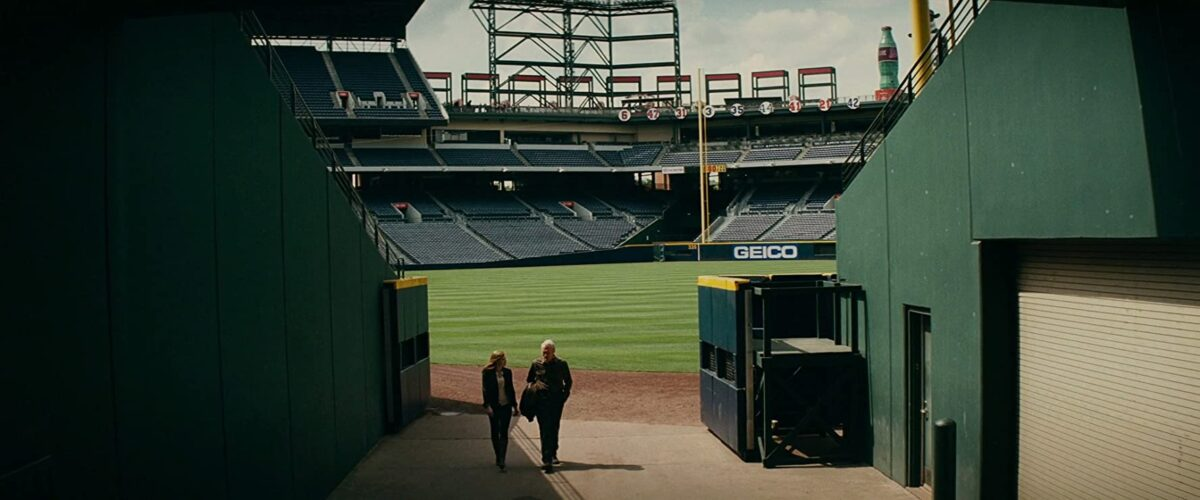 "man and woman walk out of baseball stadium in ""Trouble with the Curve"""