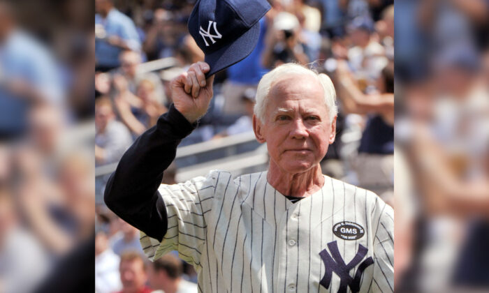Hall of Fame member Whitey Ford tips his cap during introductions for the New York Yankees 64th Old-Timers' Day game before they played the Tampa Bay Rays in their MLB American League baseball game at Yankee Stadium in New York City, on July 17, 2010. (Ray Stubblebine/Reuters)