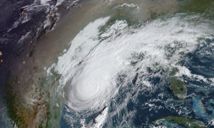 This GOES-16 GeoColor satellite image taken on Oct. 9, 2020, at 10:00 a.m. EDT, shows Hurricane Delta in the Gulf of Mexico. (NOAA via AP)