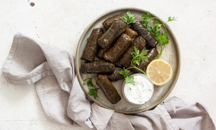 Hand-rolled dolmades, stuffed with herbed rice, are more time-consuming to prepare but highly rewarding to eat. (Von Viktoria Hodos)