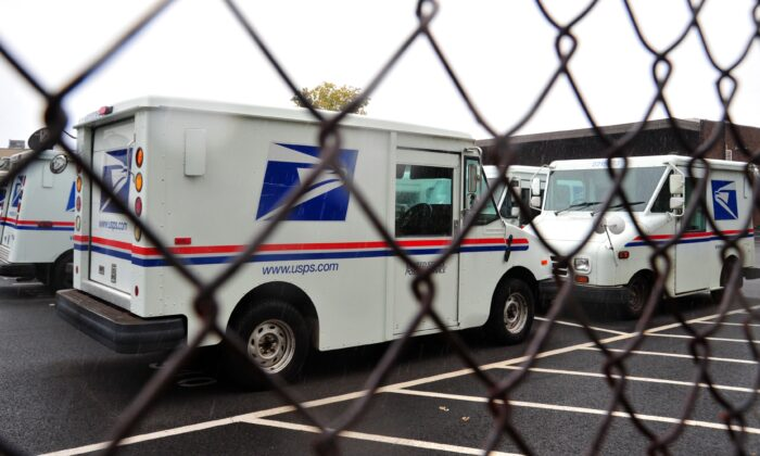 U.S. Postal Service delivery trucks at the Manassas Post Office in Virginia in a 2011 file photograph. (Karen Bleier/AFP via Getty Images)