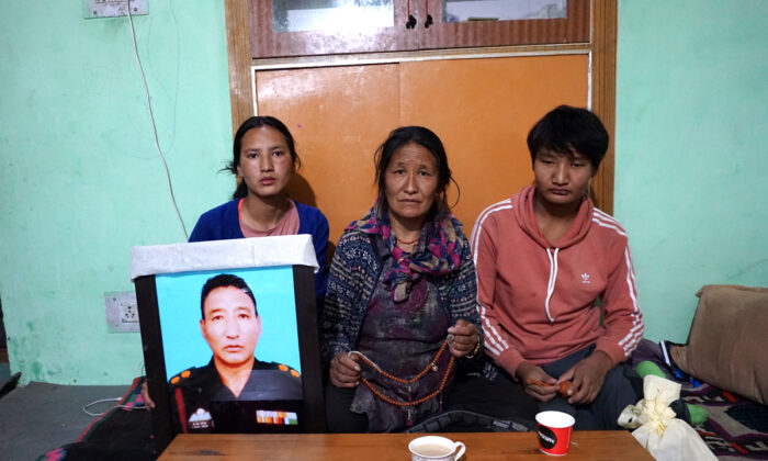 The family of Tibetan soldier, Nyima Tenzin, who died from a landmine blast on Aug. 29-30, in their home in a Tibetan refugee camp in Leh on Oct. 9, 2020. (Venus Upadhayaya/Epoch Times)