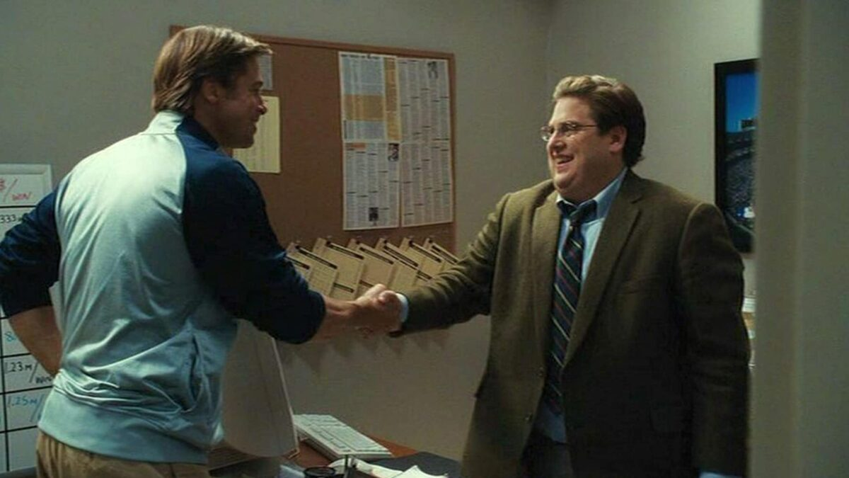 """two men shaking hands in """"Moneyball"""""""