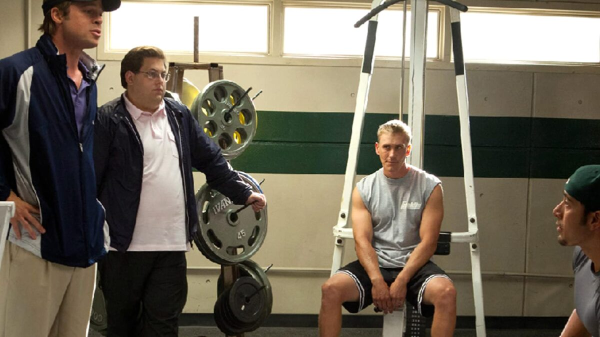 """manager and consultant and two players in locker room in """"Moneyball"""""""