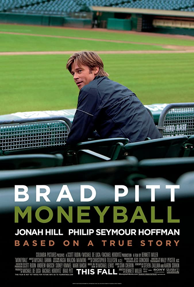 """man sitting in bleachers on a movie poster for """"Moneyball"""""""