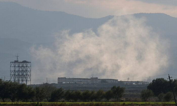 Smoke rises as Azerbaijan forces shell targets during the fighting over the breakaway region of Nagorno-Karabakh near the city of Terter, Azerbaijan, on Oct. 9, 2020. (Umit Bektas/ Reuters)