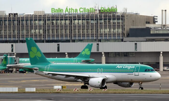 Aer Lingus passenger jets taxi at Dublin Airport in Ireland, on Jan. 27, 2015. (Paul Faith/AFP via Getty Images)