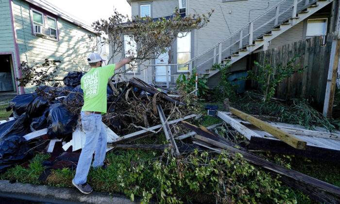Caleb Cormier moves debris after Hurricane Delta moved through, in Lake Charles, La., on Oct. 10, 2020. (Gerald Herbert/AP Photo)