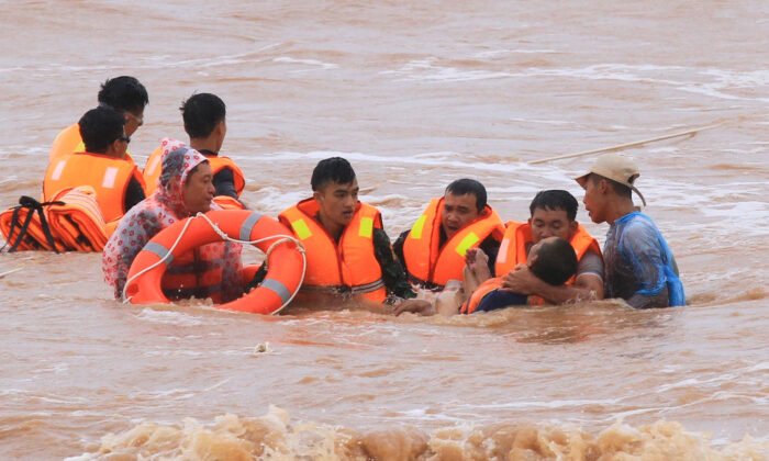 Military personnel rescue sailors of a ship at Cua Viet Port in Quang Tri province, Vietnam, on Oct. 11, 2020. (Ho Cau/VNA via Reuters)
