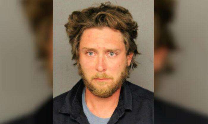 Matthew Dolloff, 30, in a booking photograph. (Denver Police Department)