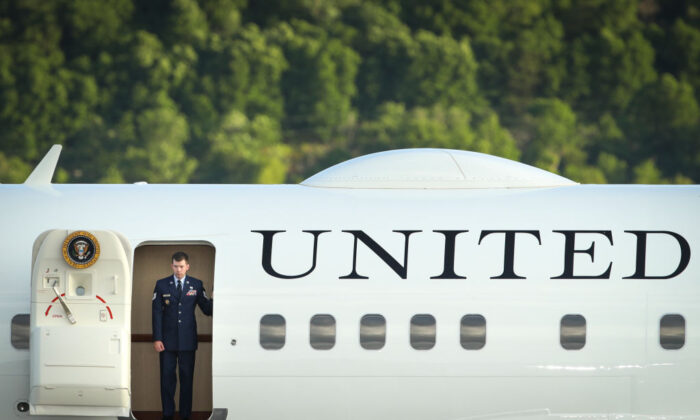 A member of the U.S. Air Force peers out the door as Air Force One arrives at Williamsport Regional Airport, May 20, 2019, in Montoursville, Penn.  (Drew Angerer/Getty Images)