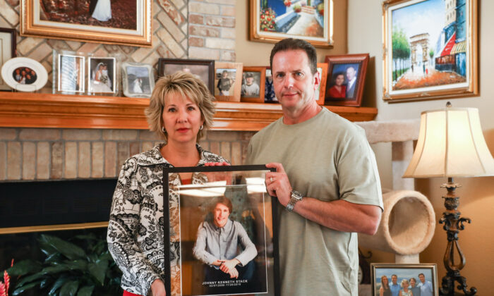 Laura and John Stack hold a memorial photo of their son, Johnny, in their home at Highlands Ranch, in southern Denver, Colo., on Oct. 1, 2020. (Charlotte Cuthbertson/The Epoch Times)