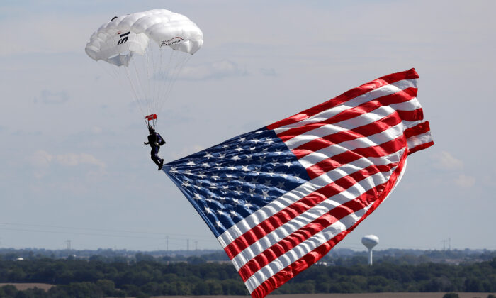 The American Flag is flown in to Chicagoland Speedway in Joliet, Ill., on Sept. 18, 2016.  (Jonathan Daniel/Getty Images)