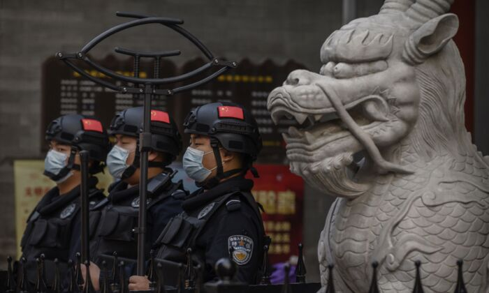 Chinese security stand guard in a shopping area in Beijing, on Oct. 8, 2020. (Kevin Frayer/Getty Images)