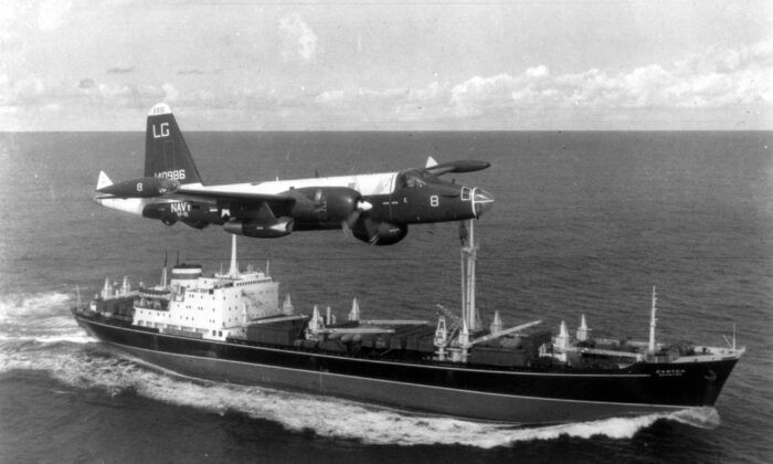 A P2V Neptune U.S. patrol plane flies over a Soviet freighter during the Cuban Missile Crisis in October 1962. The crisis brought the world to the verge of nuclear catastrophe. (MPI/Getty Images)