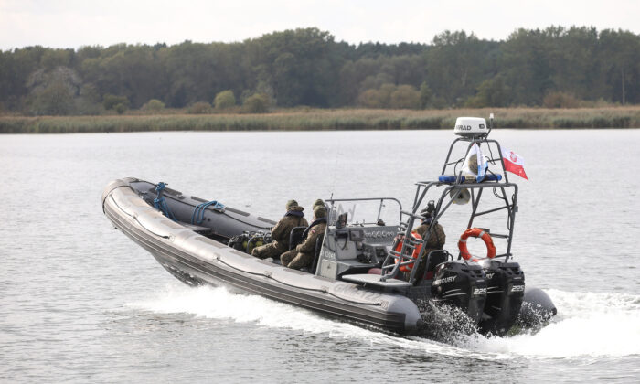 Navy divers from the 12th Minesweeper Squadron of the 8th Coastal Defense Flotilla take part in a five-day operation to defuse the largest unexploded World War Two Tallboy bomb ever found in Poland in Swinoujscie, Poland, on Oct. 12, 2020. (Agencja Gazeta/Cezary Aszkielowicz via Reuters)