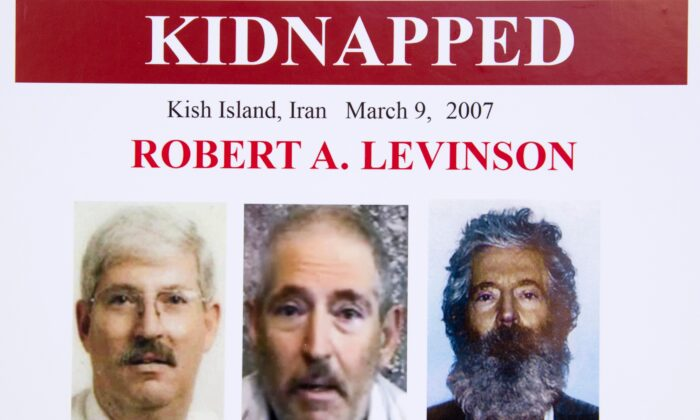 An FBI poster showing a composite image of former FBI agent Robert Levinson (R), of how he would look like now after five years in captivity, and an image, center, taken from the video, released by his kidnappers, and a picture before he was kidnapped (L), displayed during a news conference in Washington, on March 6, 2012. (Manuel Balce Ceneta/AP Photo)