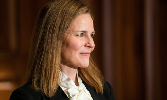 Judge Amy Coney Barrett meets with Sen. Bill Cassidy (R-La.) at the United States Capitol Building in Washington on Oct. 1, 2020. (Jim Lo Scalzo/Pool via Reuters)