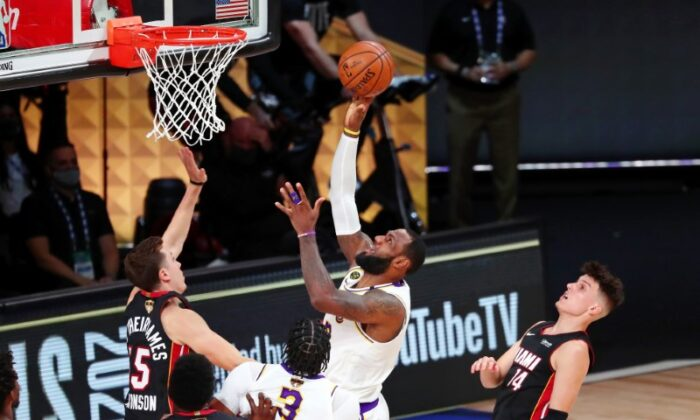 Los Angeles Lakers forward LeBron James (23) shoots in front of Miami Heat guard Duncan Robinson (55) during the third quarter in game six of the 2020 NBA Finals at AdventHealth Arena in Lake Buena Vista, Fla., on Oct 11, 2020. (Kim Klement-USA TODAY Sports)