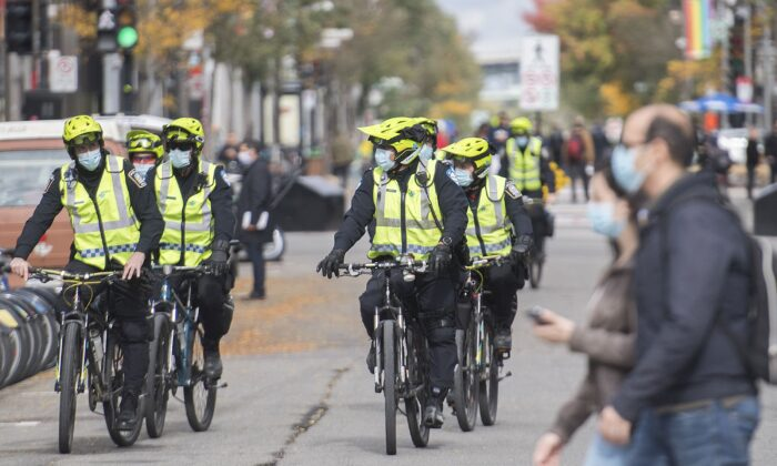 Police patrol Saint-Catherine Street in Montreal on Oct. 3, 2020. (The Canadian Press/Graham Hughes)