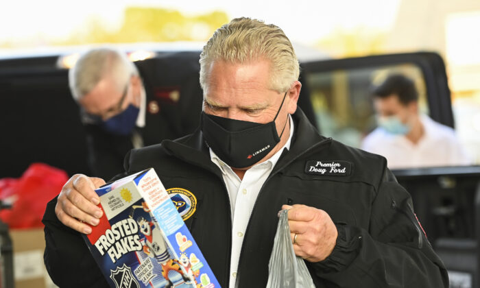 Ontario Premier Doug Ford delivers food at the Salvation Army food bank during the COVID-19 pandemic in Toronto on Oct. 9, 2020. (Nathan Denette/The Canadian Press)