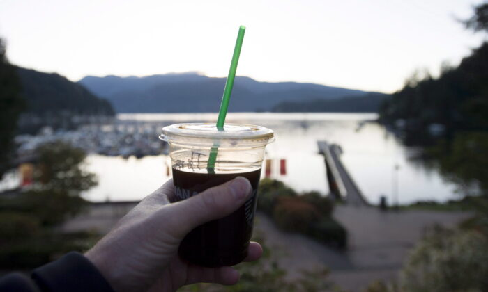 A plastic straw is pictured in a take away coffee cup in Deep Cove in North Vancouver, B.C., on May, 11, 2018. (Jonathan Hayward/The Canadian Press)