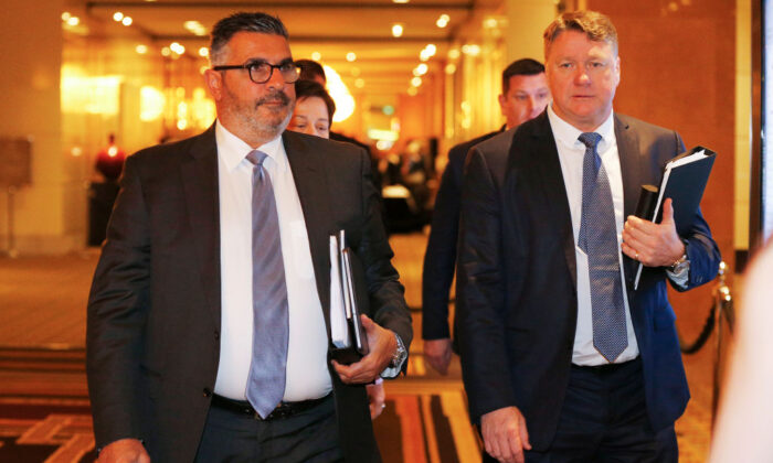 Andrew Demetriou (L) and Michael Johnston (R), non executive Directors of Crown, leaves the Crown Resorts AGM on October 24, 2019 in Melbourne, Australia. (Daniel Pockett/Getty Images)