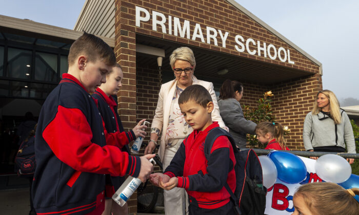 Students sanitize before entering for the first day back at Lysterfield Primary School in Melbourne, Australia on May 26, 2020. (Daniel Pockett/Getty Images)