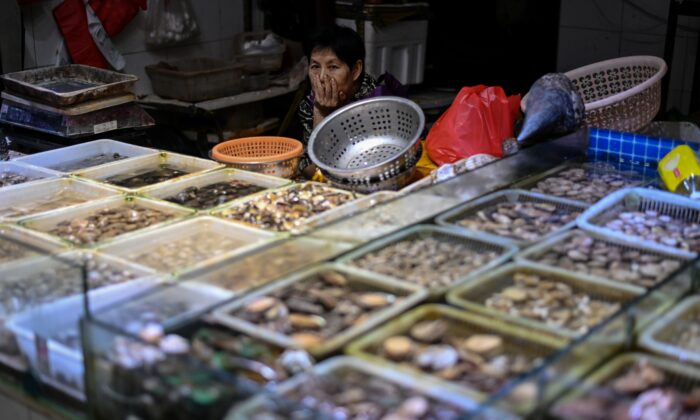 A seafood vendor is waiting for customers at the Huahuan Zhenbei agricultural products market in Shanghai, on Aug. 25, 2020. (Hector Retamal/AFP via Getty Images)