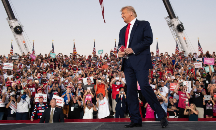 President Donald Trump arrives to hold a Make America Great Again rally as he campaigns at Orlando Sanford International Airport in Sanford, Fla., on Oct. 12, 2020. (Saul Loeb/AFP via Getty Images)